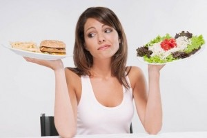 Woman-choosing-between-a-hamburger-plate-and-a-salad-plate